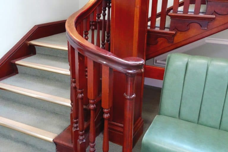 Stair spindle colored with a dark brown varnish finish, How To Paint Stair Spindles Without Removing Them?