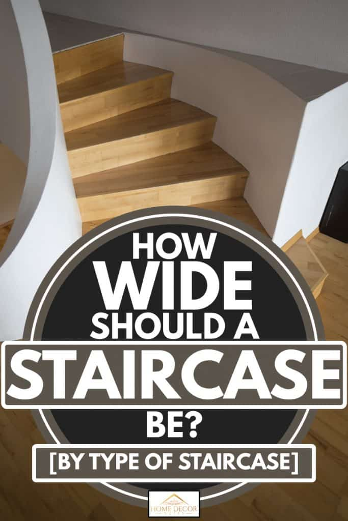 A vertical shot of a curved wooden stairs, How Wide Should A Staircase Be [By Type of Staircase]?