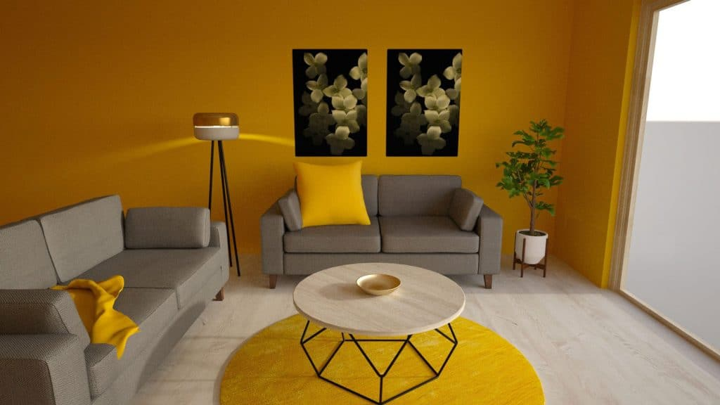 A yellow painted living room with two couches and yellow throwpillows