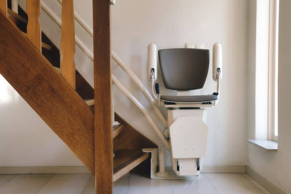 Automatic stairlift on staircase for elderly or disability in a house