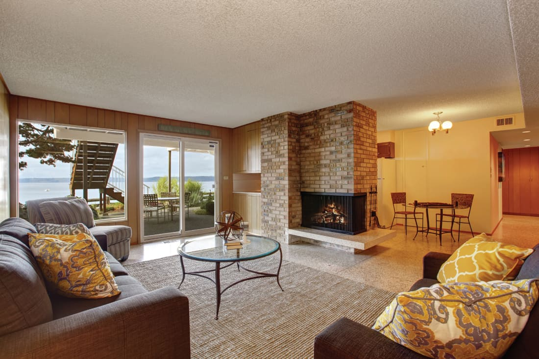 Basement living room with fireplace and walkout patio