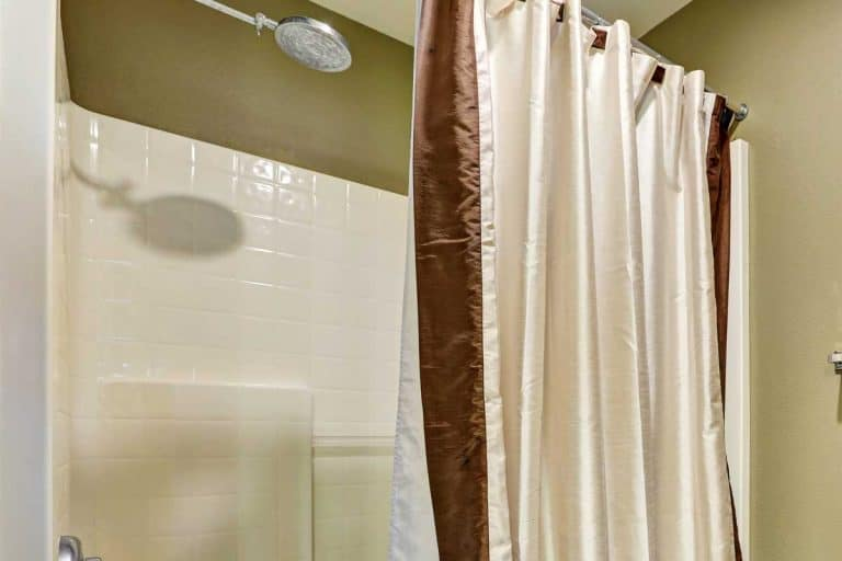 Bathroom shower with tile walls and shower curtain liner, 5 Best Shower Curtain Liners to avoid Mildew and Mold
