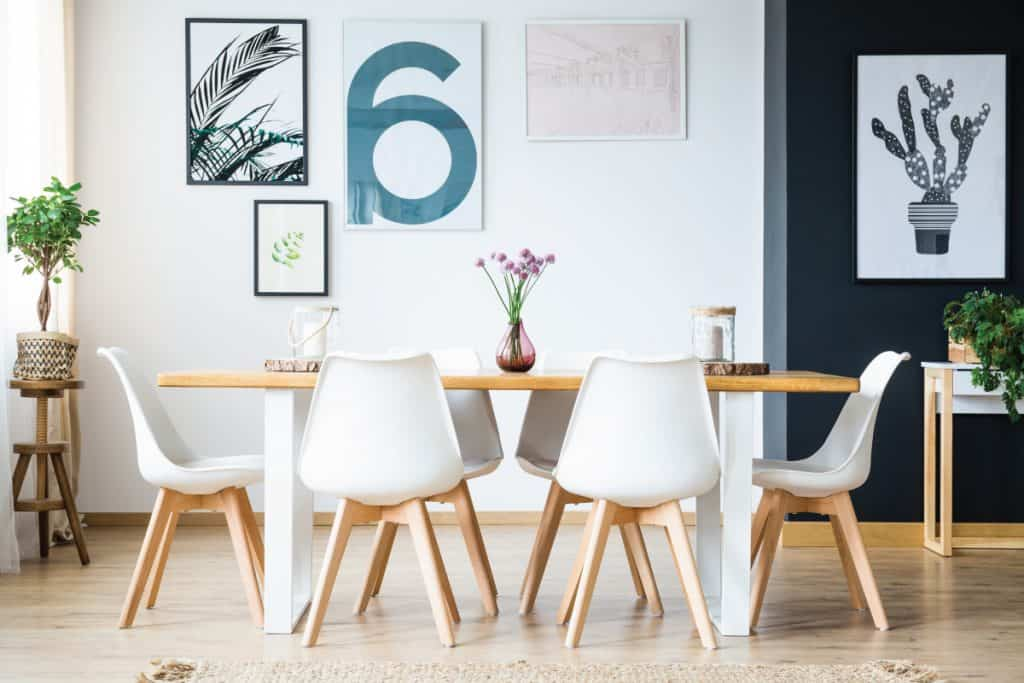 Big bright dining room with plant decoration