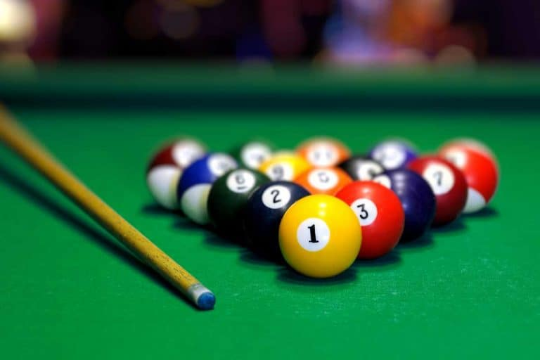 Billiard balls in a green pool table, Can You Put A Pool Table In A 12 x 12 Room?