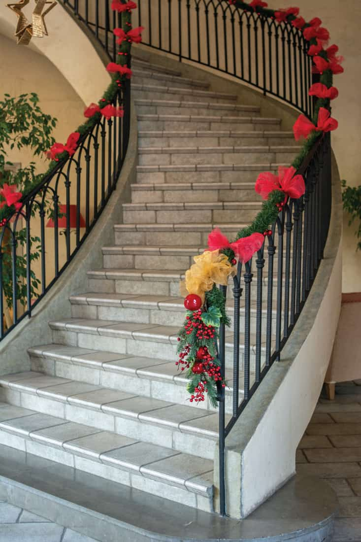 Christmas Decoration Stair artificial garland placed for pattern interior design on staircase or mantels in Christmas and New year party holiday