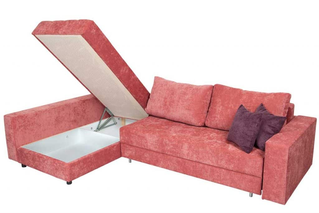 Corner convertible sofa bed with storage space and upholstery soft pink fabric isolated on a white background