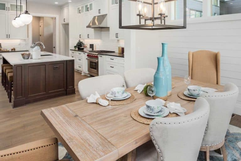 Dining room and kitchen interior in new luxury home, Should the Dining Table Match the Kitchen Cabinets?