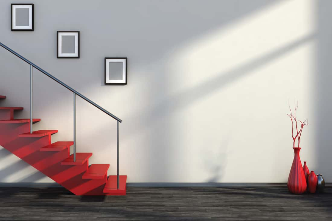 Empty interior with red stairs and vase
