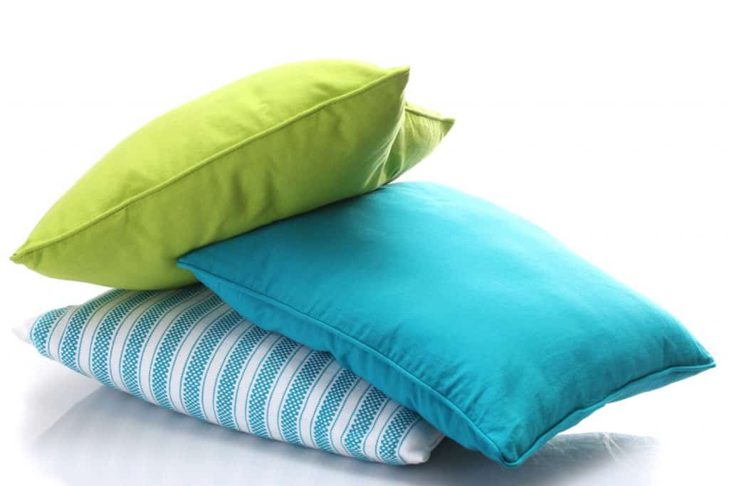 Four different colored memory foam pillows