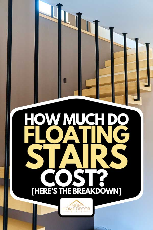 Ash lumber stairs with railing attached to brown wall and leading to second floor inside stylish modern house, How Much Do Floating Stairs Cost? [Here's the Breakdown]
