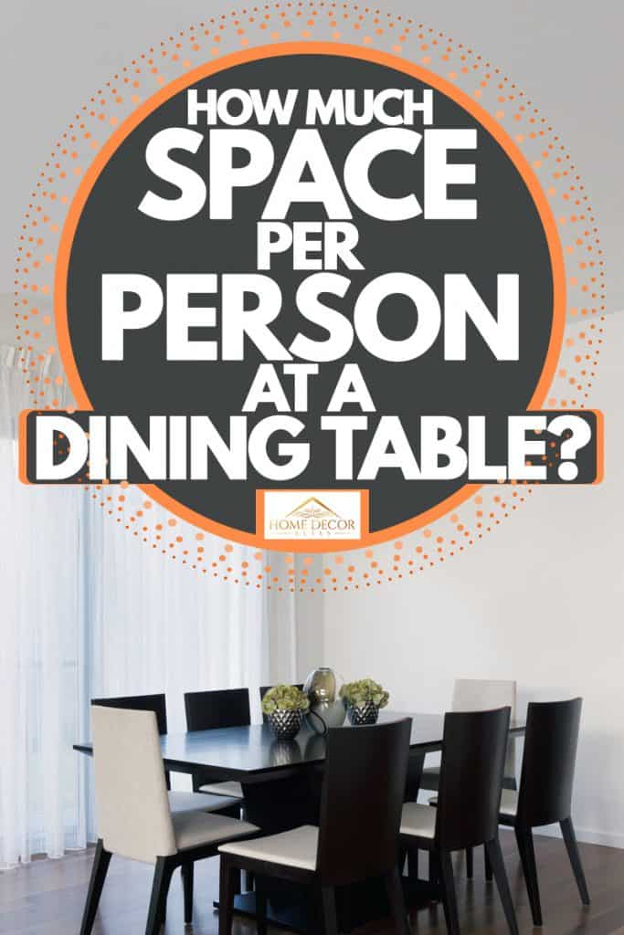 A modern dining room with luxurious black painted wooden chair a dark granite dining table, and a huge sliding door on the background, How Much Space Per Person At A Dining Table?