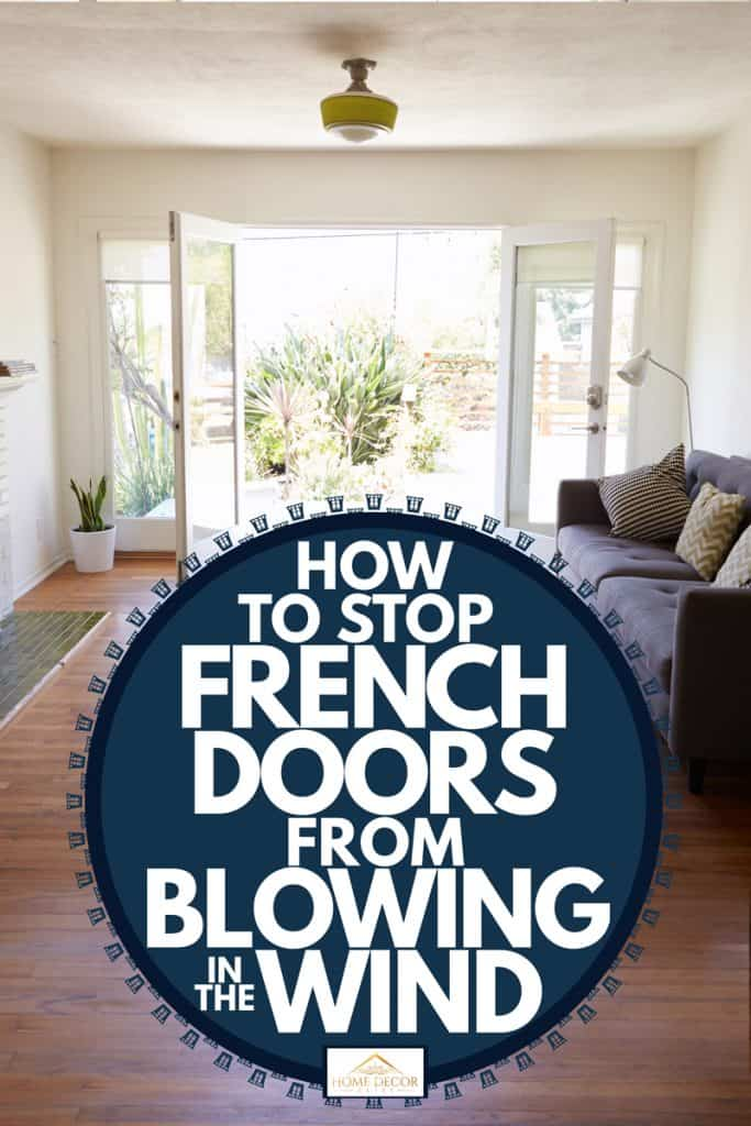 A classic contemporary house with a simple French doorway leading to a living room with wooden paneled flooring, How to Stop French Doors From Blowing in the Wind