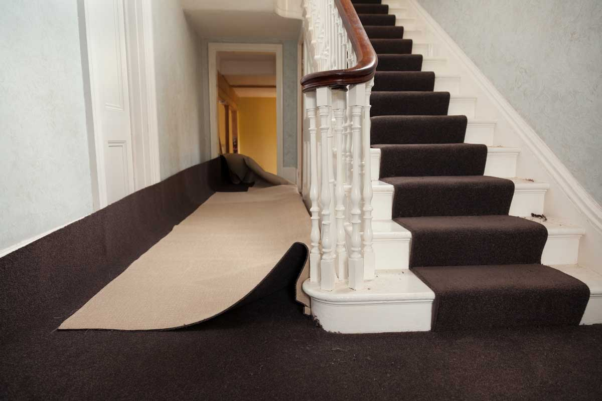 Installation of carpet in hallway of house
