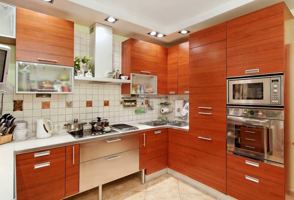 Kitchen interior with wooden furniture and built in utensils