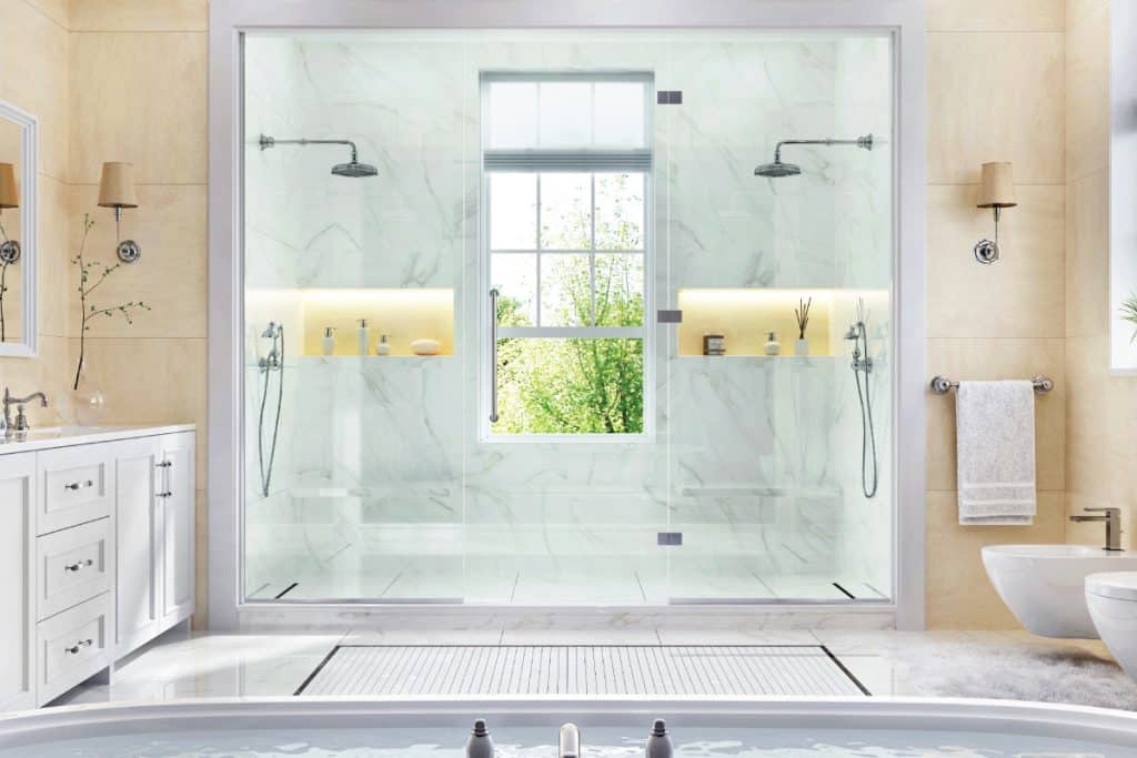 Luxurious bathroom with bathtub, large shower and window