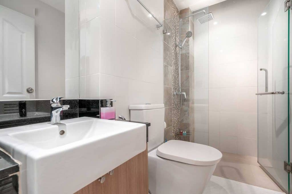 Luxury bathroom features toilet bowl and basin