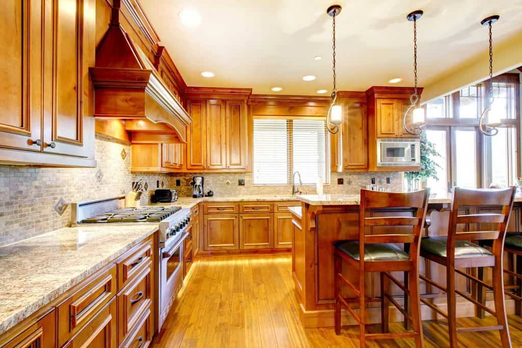 Luxury mountain home wood kitchen with island table