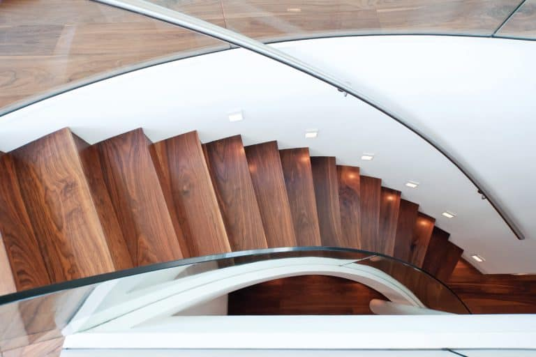 Curved staircase of a modern home, How Wide Should A Staircase Be [By Type of Staircase]?