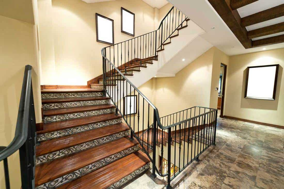 New home interior with wooden stairs and carpet, Should Stairs Match The Flooring That's Upstairs Or Downstairs?