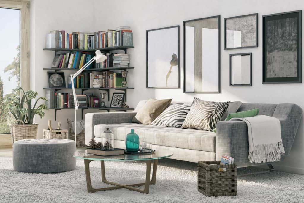 A cozy living room with corner bookshelf and a carpet