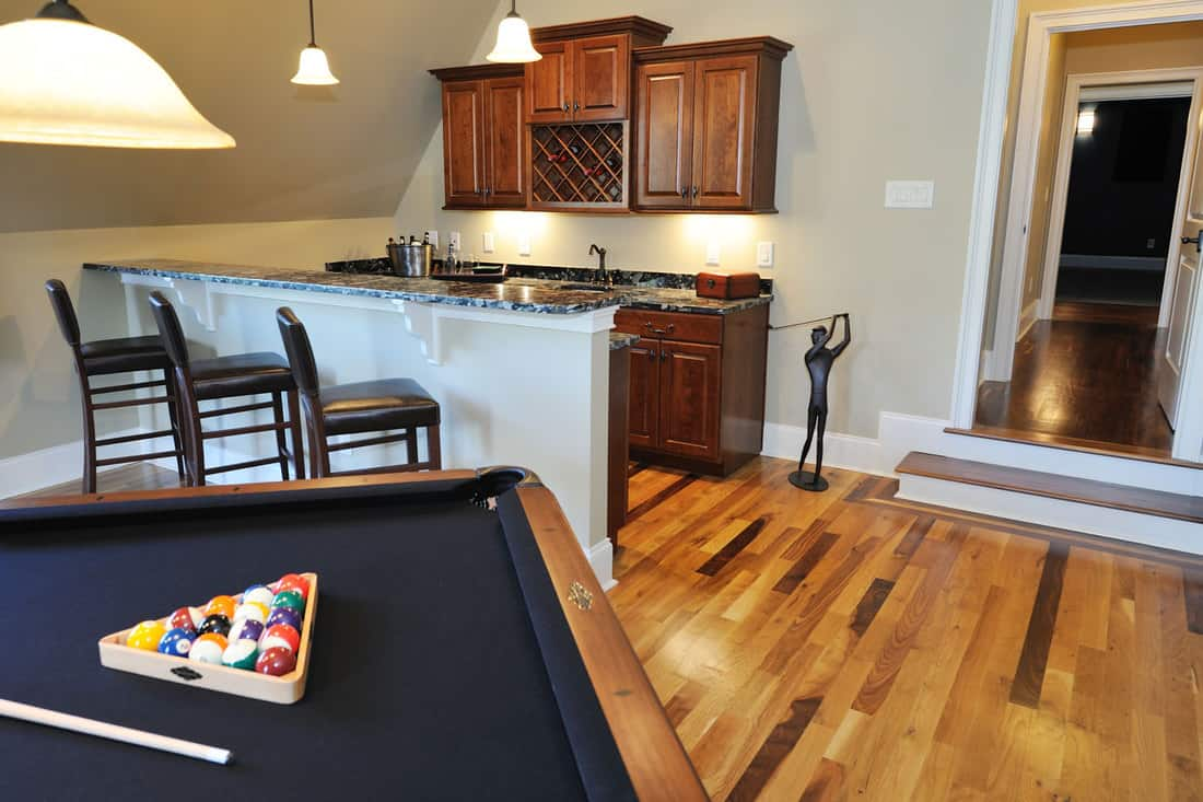 Pool Table in home interior flex room,What To Do With An Empty Room? (9 Flex Room Ideas)