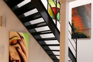 How to Hang Art on Staircase Wall [Inc. Picture Arrangement Tips]