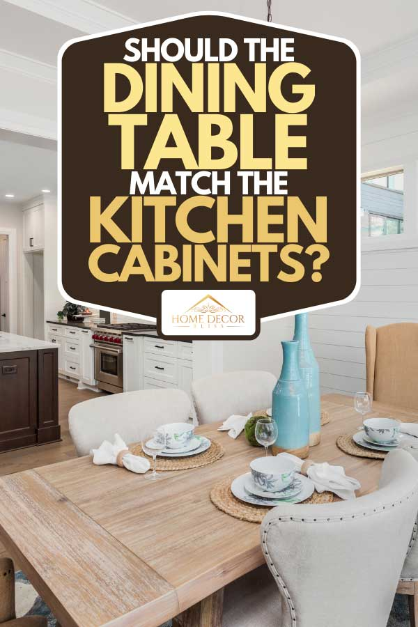 Dining table and kitchen interior in new luxury home, Should the Dining Table Match the Kitchen Cabinets?