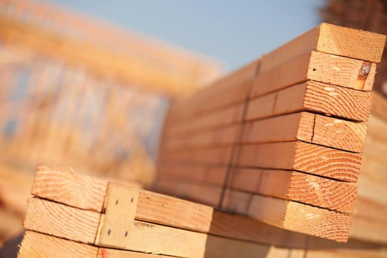 Stack of lumber at a construction site, 14 Best Types Of Wood For Stair Treads