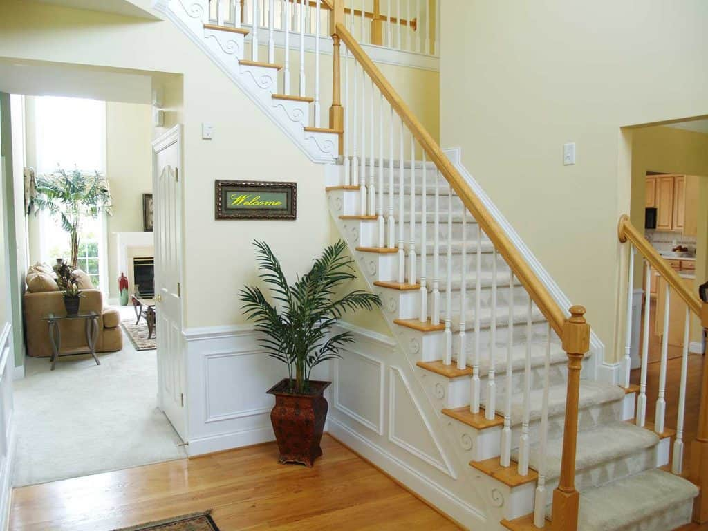 Stairs inside of a modern home with welcome sign