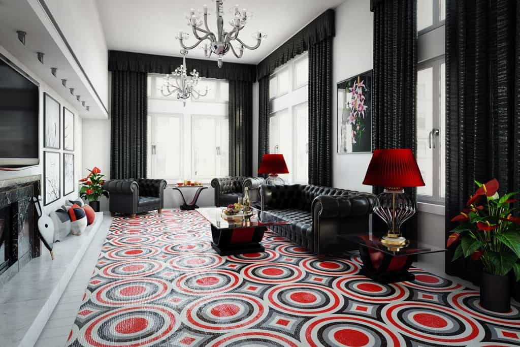 Stylish home interior design with black chesterfield sofa and armchairs