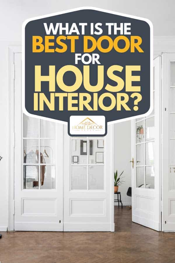 A renovated townhouse white interior with open, wooden doors and hardwood floor, What Is The Best Door For House Interior?