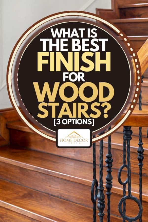 A classic vintage elegant wooden staircase with wrought iron railing, What Is The Best Finish For Wood Stairs? [3 Options]