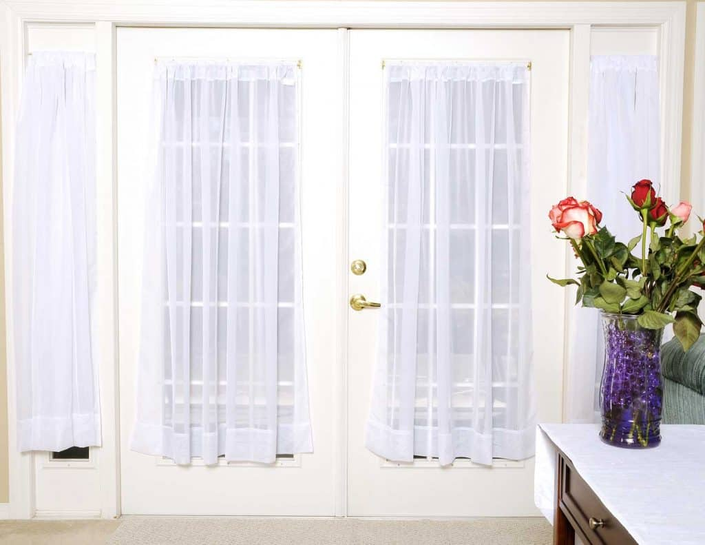 White French doors with sheer curtains
