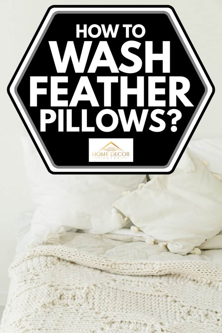 White pillows on white bed, how to wash feather pillows