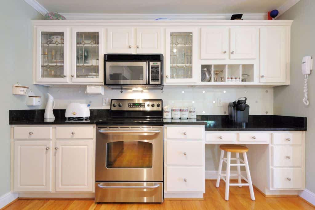 White themed kitchen with white laminated kitchen cabinet panels