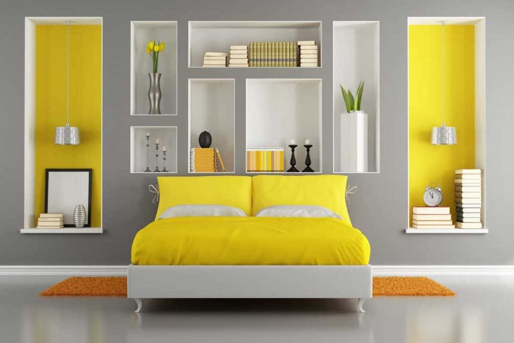 Yellow and gray modern bedroom with double bed and niche