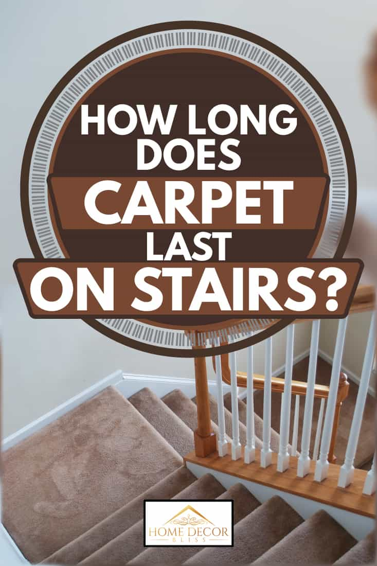 brown carpeted stairway with wooden handrail, how long does carpet last on stairs