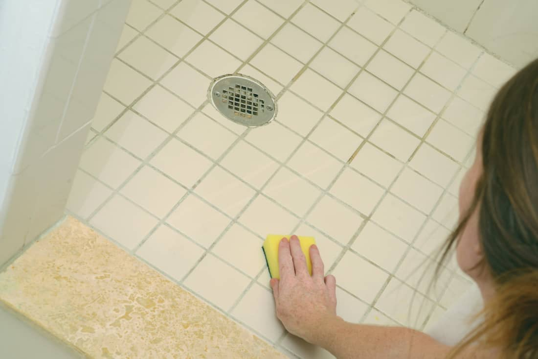 cleaning shower and soap scum