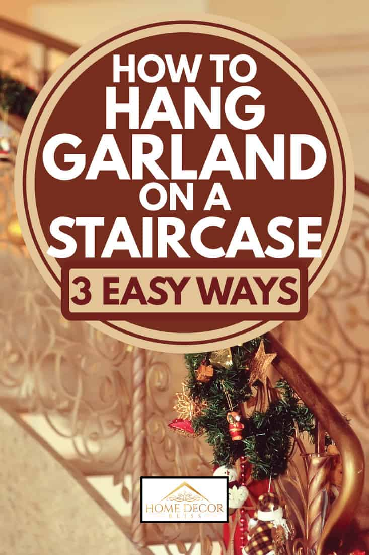 decorated metal handrails for the holidays, how to hang garland on a staircase [3 easy ways]