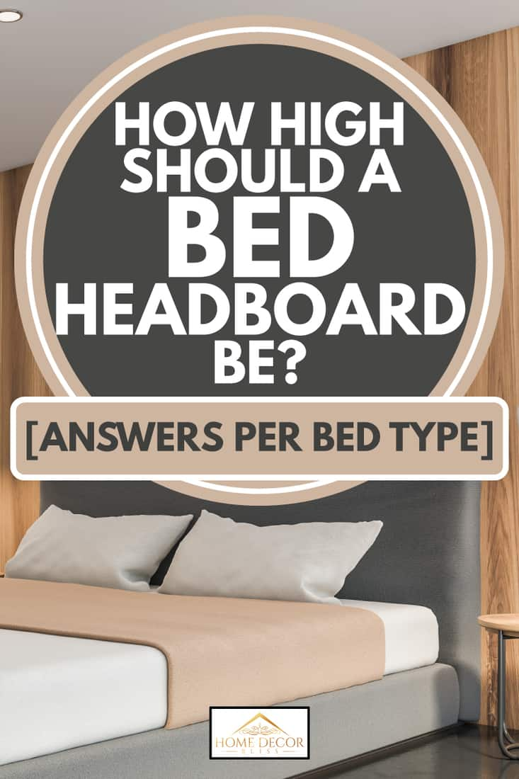 grey headboard on white bed and wooden accented room, How High Should A Bed Headboard Be [Answers per bed type]