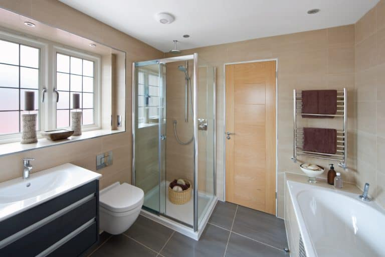 guest bathroom in a luxury house with toilet bathtub and sink, what is the minimum shower door width