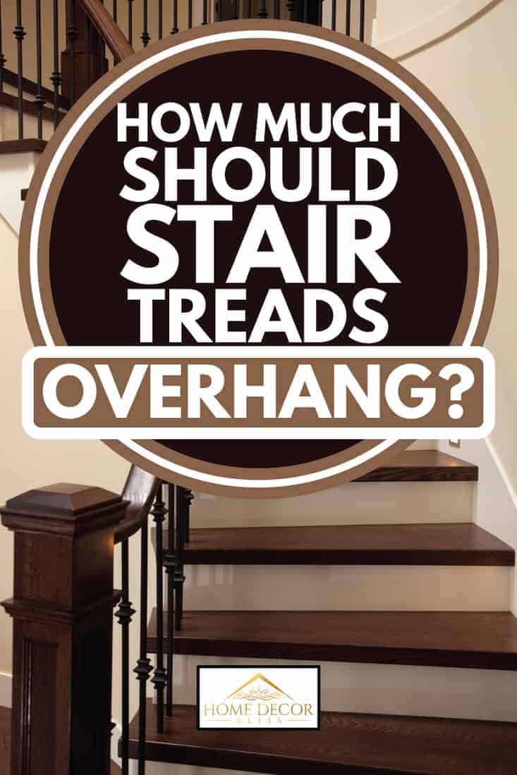 interior stairway with dark colored treads and light accents, how much should stair treads overhang