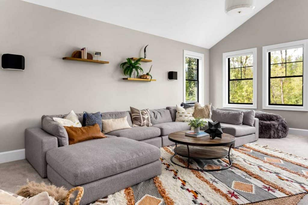 Living room in newly constructed luxury home with corner sofa