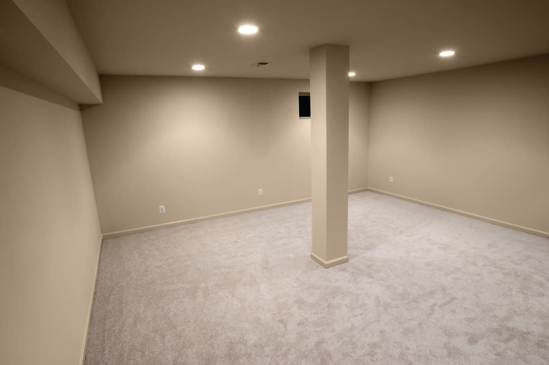 newly constructed basement empty interior with single column in the center