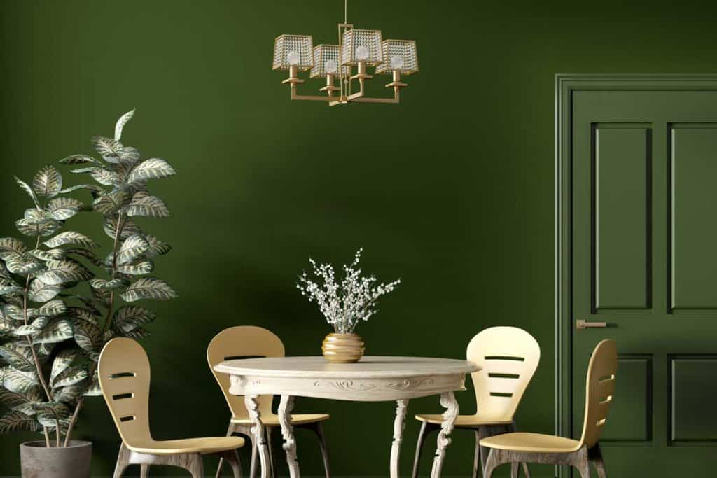 Modern dining room interior with wooden classic table and yellow chairs against dark green wall