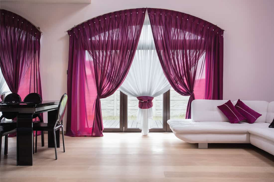 Rose colored curtains for a modern interior house