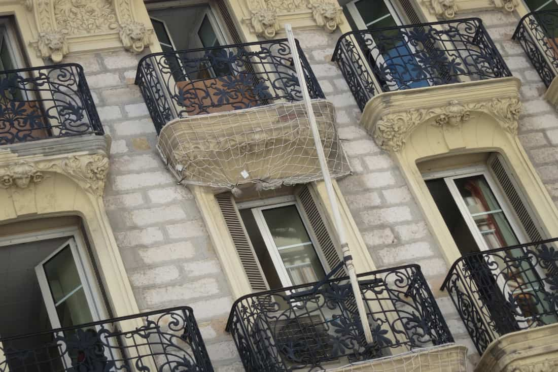 six balconies with cast iron fences and french windows