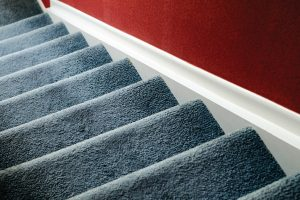 Should Stairs Be Carpeted Or Wood?