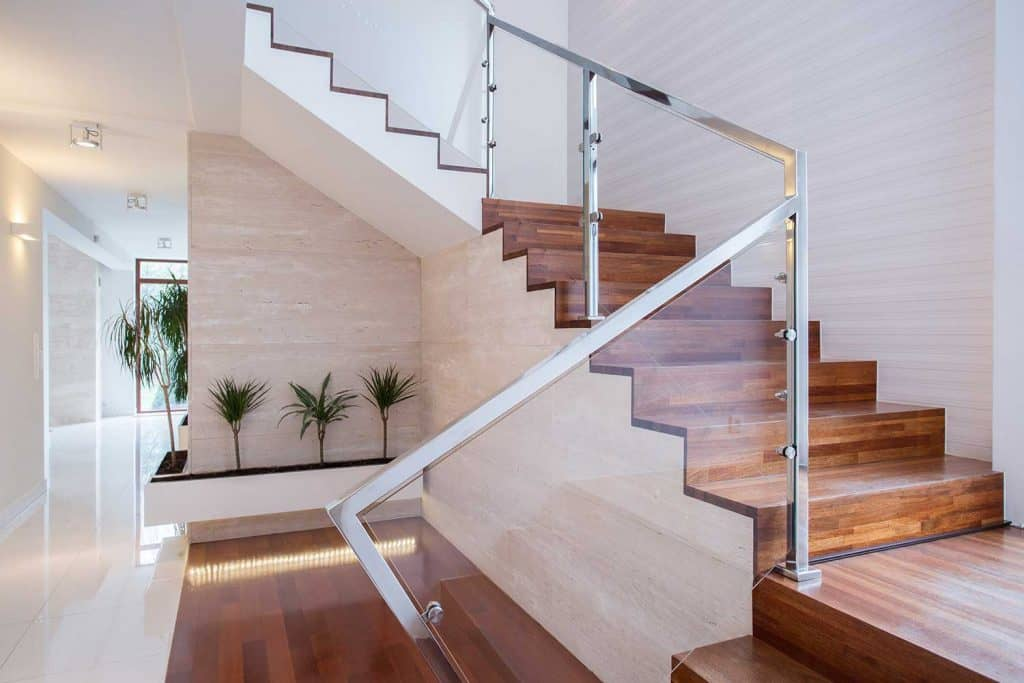 Stylish staircase in bright house interior