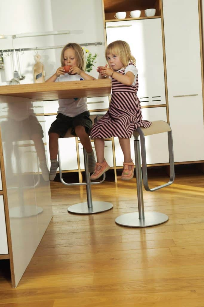 Two girls sitting in the kitchen bar
